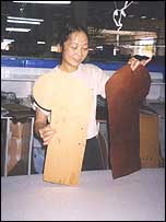 Woman cutting sofa arm shapes