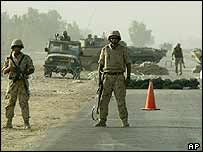 Coalition troops block a road leading into the holy city of Karbala