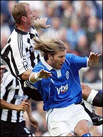 Robbie Savage challenges Alan Shearer for a header