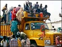 Somali nationals board a truck in Djibouti which will transport them to a camp at Aour-Aoussa in the south of the country