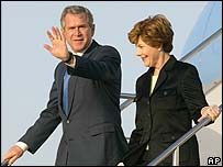 President and Mrs Bush leaving Air Force One in Tokyo