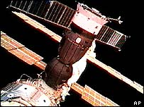 The Soyuz space vehicle is shown docked at the International Space Station