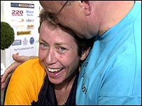 Jane Tomlinson is congratulated by her husband