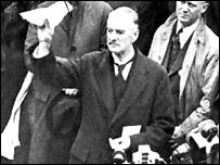 Neville Chamberlain with his piece of paper, returning from Munich