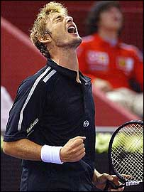 Juan Carlos Ferrero is delighted after his win over Paradorn Srichaphan