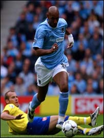 Man City striker Niclas Anelka runs clear of the grounded Freddy Ljungberg