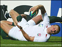 Mike Tindall is denied a try by Joe van Niekerk's tackle
