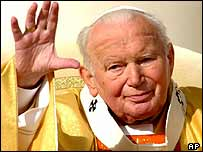 Pope John Paul II waves to the crowd in St Peter's Square, 19 October 2003