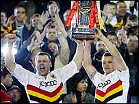 Bradford Bulls' James Lowes and Robbie Paul lift the trophy