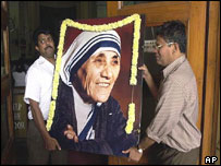 Volunteers carry a portrait of Mother Teresa into a church in New Delhi