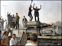 Iraqis celebrate the destruction of a US vehicle