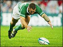 Irish centre Kevin Maggs dives after the ball
