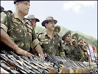 soldiers with seized weapons