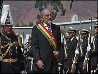 President Mesa reviewing troops