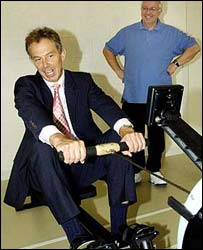 Tony Blair trying out a rowing machine