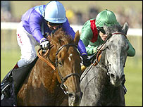 Persian Punch (left) clinches victory in the Jockey Club Cup at Newmarket