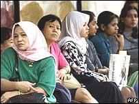 Malaysian women at a bus stop