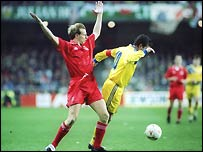 Paul Bodin (left) tussles with Gheorghe Hagi