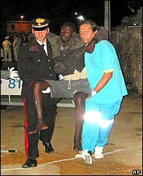 Italian policeman and medic aid survivor in Lampedusa