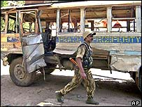 Bus wreckage after suspected militant attack