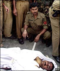 Indian soldiers display the body of the man they say is Ghazi Baba