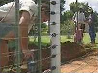 South African farmer builds a security fence