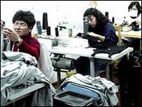 Peruvian women sewing cotton