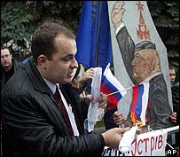 Ukrainian demonstrator burns Russian flag