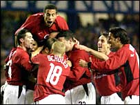 Man Utd celebrate Phil Neville's early goal