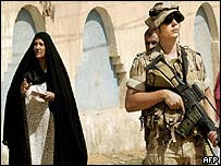 Iraqi woman and US soldier