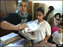 Iraqi schoolteacher hands over