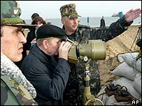 Ukrainian President Leonid Kuchma observes the building work from Tuzla island