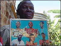 Theresa Nakanwagi , with photos of her family