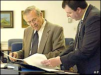 Donald Rumsfeld (left)