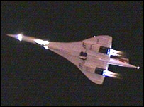 The Concorde's afterburners tailed off into the night sky
