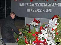 Russian President Vladimir Putin lays flowers at the monument to those who died in the theatre hostage crisis on the anniversary of the attack