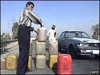 An Iraqi sells fuel on the roadside in Baghdad