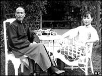 Chiang Kai-shek and his wife, Soong May-ling, are photographed in the garden of their home at Nanchang