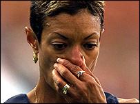 Regina Jacobs rubs her nose