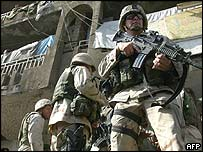 US troops stand guard at the scene of a rocket attack in Baghdad