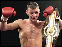 Nicky Cook retained his Commonwealth featherweight title