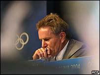 Chief Olympic Games inspector Denis Oswald seen through journalists at a press briefing in Athens