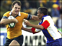 Australia's David Croft holds off a Namibian defender with ease
