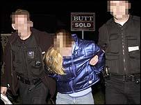 One woman led away following raid
