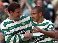Henrik Larsson celebrates his second goal with Alan Thompson