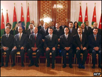King Abdullah II of Jordan (front row C) and new Prime Minister Faisal al-Fayez (3rd L) pose for a group photo with the newly named cabinet