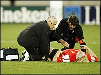 Duncan Jones is treated by the Welsh medical staff after being injured