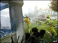 Firemen fight a blaze at a home in San Bernardino County