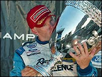 Paul Tracy kisses the Champ Car World Series trophy