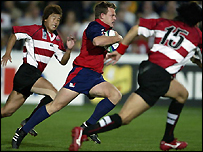Mike Hercus breaks through the Japanese defence